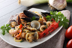 Italian pasta with seafood, mussels, clams, shrimp and squid Royalty Free Stock Photos