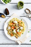 Italian pasta with seafood on plate Stock Photos