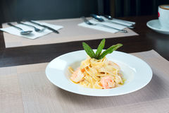 Italian pasta with shrimps. And basil on a plate Royalty Free Stock Photo