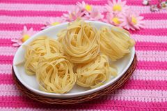Italian pasta. Some raw italian pasta in a bowl Stock Photography