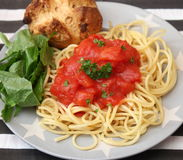 Italian pasta. Some italian pasta with a sauce of tomatoes Royalty Free Stock Images