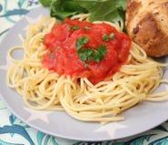 Italian pasta. Some italian pasta with a sauce of tomatoes Stock Photos