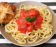 Italian pasta. Some italian pasta with a sauce of tomatoes Stock Image