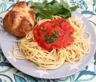 Italian pasta. Some italian pasta with a sauce of tomatoes Stock Photo