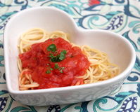 Italian pasta. Some italian pasta with a sauce of tomatoes Stock Images