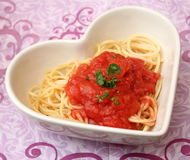 Italian pasta. Some italian pasta with a sauce of tomatoes Stock Photography