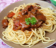 Italian pasta. Some italian pasta with a sauce of tomatoes with pork meat Stock Photography