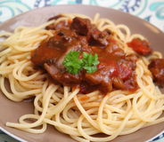 Italian pasta. Some italian pasta with a sauce of tomatoes with pork meat Royalty Free Stock Photos