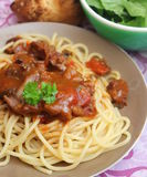 Italian pasta. Some italian pasta with a sauce of tomatoes with pork meat Stock Image