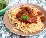 Italian pasta. Some italian pasta with a sauce of tomatoes with pork meat Royalty Free Stock Image
