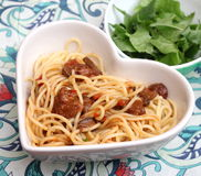 Italian pasta. Some italian pasta with a sauce of tomatoes with pork meat Royalty Free Stock Images