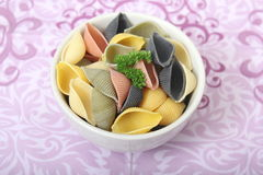 Italian Pasta. Some uncooked italian pasta in different colors stock image
