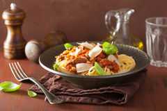 Italian pasta spaghetti bolognese with basil on rustic table Royalty Free Stock Photography