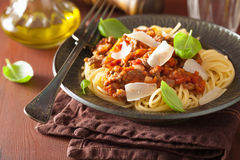 Italian pasta spaghetti bolognese with basil on rustic table Stock Photography