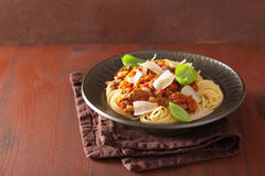 Italian pasta spaghetti bolognese with basil on rustic table Royalty Free Stock Photos