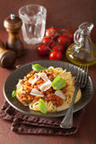 Italian pasta spaghetti bolognese with basil on rustic table Royalty Free Stock Image