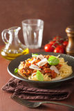 Italian pasta spaghetti bolognese with basil on rustic table Stock Photo