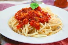 Italian pasta dish. Italian pasta spaghetti with bolognese sauce and basil Royalty Free Stock Photos