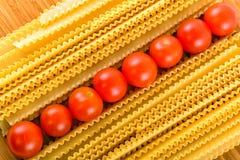 Italian pasta spaghetti and cherry tomato Stock Images