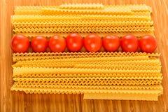Italian pasta spaghetti and cherry tomato Stock Photography