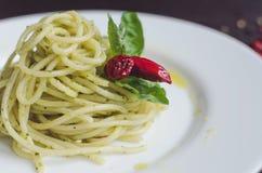 Italian pasta spaghetti with homemade pesto sauce and basil leaf Stock Photography