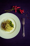 Italian pasta spaghetti with homemade pesto sauce and basil leaf Royalty Free Stock Image
