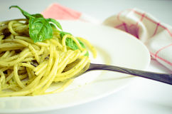 Italian pasta spaghetti with homemade pesto sauce and basil leaf Royalty Free Stock Images