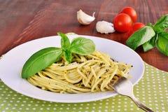 Italian pasta spaghetti with pesto sauce and basil leaf. Royalty Free Stock Photo