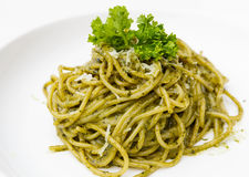 Italian pasta spaghetti with pesto sauce and basil leaf Royalty Free Stock Photos