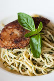 Italian pasta spaghetti with pesto sauce and striped bass Royalty Free Stock Image