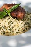 Italian pasta spaghetti with pesto sauce and striped bass Royalty Free Stock Photography