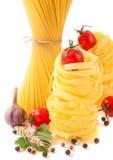 Italian pasta, spaghetti, spices and herbs Royalty Free Stock Photography