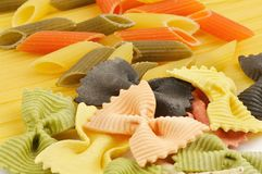 Italian pasta spaghetti, tricolore and farfalle Royalty Free Stock Images