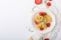 Italian Pasta Spaghetti With Fried Cherry Tomato And Thyme, Close Up Shot With Copy Space Stock Images