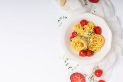 Italian Pasta Spaghetti With Fried Cherry Tomato And Thyme, Top View Stock Photo