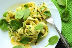 Italian pasta with spinach Stock Image