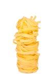 Italian pasta: tagliatelle. On white background Stock Images
