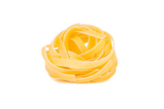 Italian pasta: tagliatelle. On white background royalty free stock images