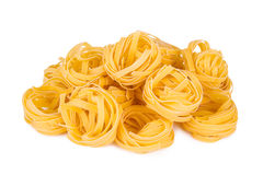 Italian pasta: tagliatelle. Isolated on white background stock photos