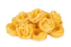 Italian pasta: tagliatelle. Isolated on white background Stock Photos