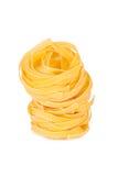 Italian pasta: tagliatelle. Isolated on white background Stock Photography