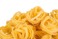 Italian pasta: tagliatelle. Isolated on white background stock images