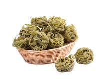 Italian pasta tagliatelle in basket. Royalty Free Stock Images