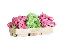 Italian pasta tagliatelle colored isolated on white Royalty Free Stock Photography
