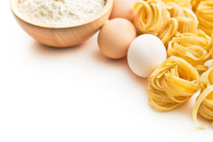 Italian pasta tagliatelle, eggs and flour Royalty Free Stock Image