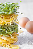 Italian pasta tagliatelle, flour and eggs Stock Photo