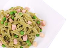 Italian pasta tagliatelle with ham. Stock Photos