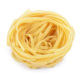 Italian pasta tagliatelle nest isolated on white background Stock Photography