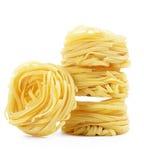 Italian pasta tagliatelle nest isolated on white background Royalty Free Stock Photos