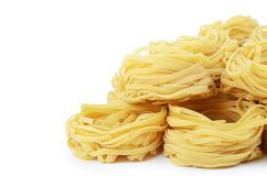 Italian pasta tagliatelle nest isolated on white background Stock Photos